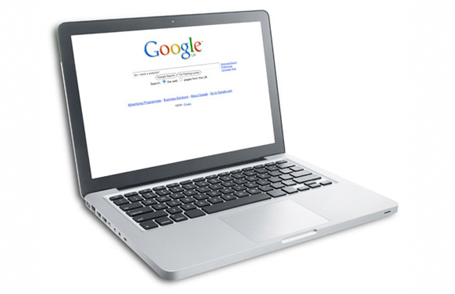 a laptop displaying the Google Search home page